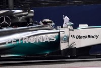 Hamilton takes title lead with Singapore win
